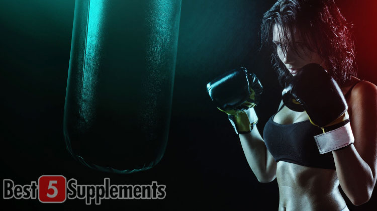 Women exercising for fat loss during intermittent fasting punching a bag