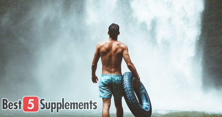 man stood in front of waterfall for best multivitamins for men