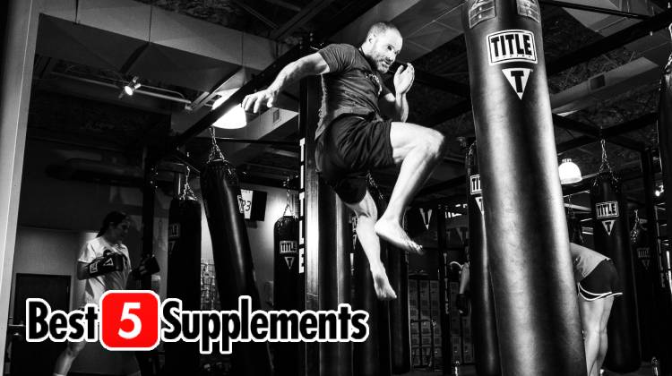 A man jumping and kicking a punchbag to show whether non-stimulant pre-workouts work