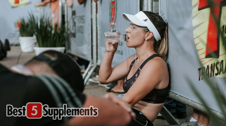 A women visibly tired during Intra-Workout consuming a supplement